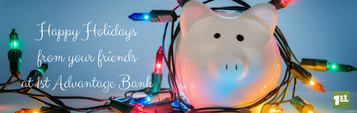 piggy bank with Christmas lights and text that says Happy Holidays from your friends at 1st Advantage Bank